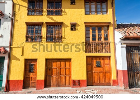 Yellow and red facade of a historic building in La Candelaria neighborhood in Bogota, Colombia - stock photo