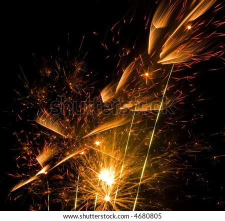 Yellow and red fireworks on night sky