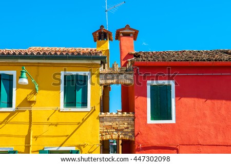 Yellow and red houses. Burano island near Venice, Italy - stock photo