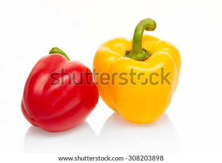 Yellow and red peppers isolated on white background. Clipping path included - stock photo
