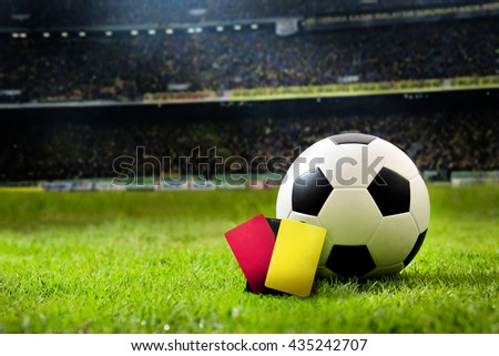 Yellow and Red soccer card. soccer field and stadium with fans the night light before the match, soccer stadium,soccer match,soccer on grass,soccer football, soccer team, soccer sport,soccer at night.