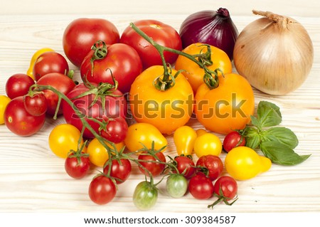 yellow and red tomatoes and onions