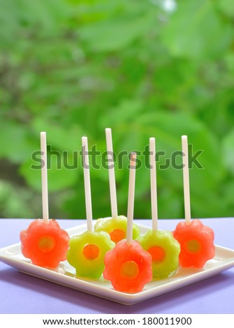 yellow and red watermelon lollipop - stock photo