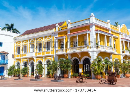 Yellow and white colonial building the historic center of Cartagena, Colombia - stock photo