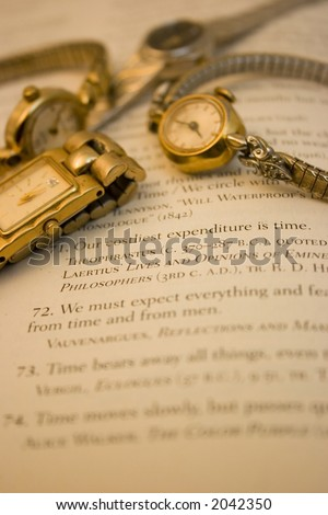 Yellow and white gold ladies watches over quotations about time.