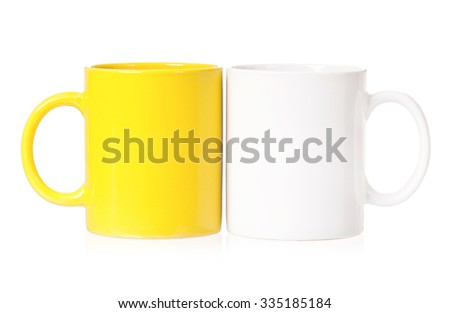 Yellow and white mugs empty blank for coffee or tea isolated on white background  - stock photo
