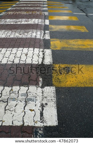 yellow and white stripes walking in city