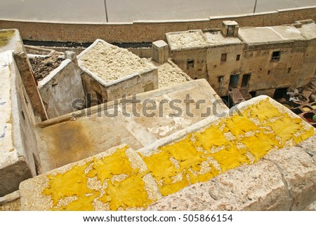 Yellow animal hudes dry on a rooftop after being tanned at leather tanneries near the Terrace de Tanneurs in the ancient medina, Fes el Bali, in Fez, Morocco.