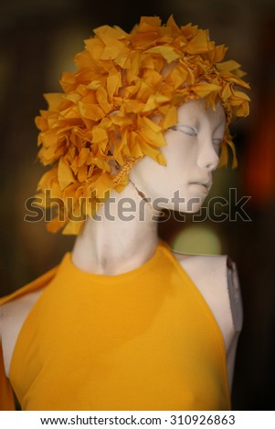 Yellow apparel on a mannequin
