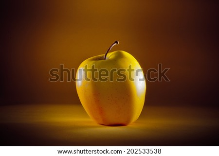 yellow apple on a yellow background