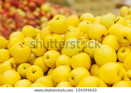 yellow apple on the shelf in the supermarket