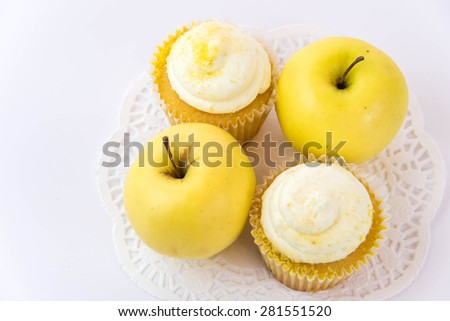 yellow apple vs yellow cupcake - snack decision between healthy food or junk food