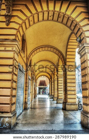 yellow arcade in Bologna, Italy - stock photo