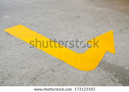 Yellow arrow lines on road