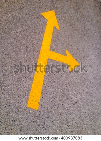 Yellow Arrow on the road, separate way