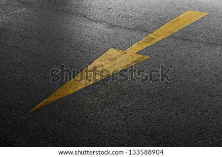 Yellow arrow on the road to forward.