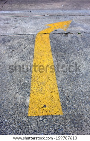 Yellow Arrow traffic on the road. - stock photo