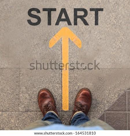 Yellow arrow with start  - stock photo