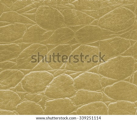 yellow artificial snake skin texture  closeup. - stock photo