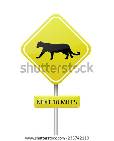 """Yellow attention sign """"Pumas crossing, next 10 miles"""" - stock photo"""
