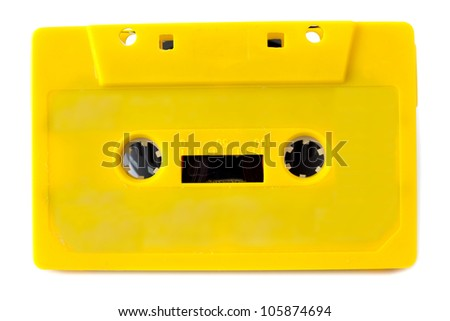 Yellow audio cassette on white background - stock photo