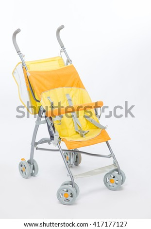 Yellow baby carriage on a white background
