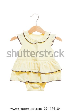 Yellow baby clothes bodysuit with ruff front view in clothes hanger, isolated on white background. - stock photo