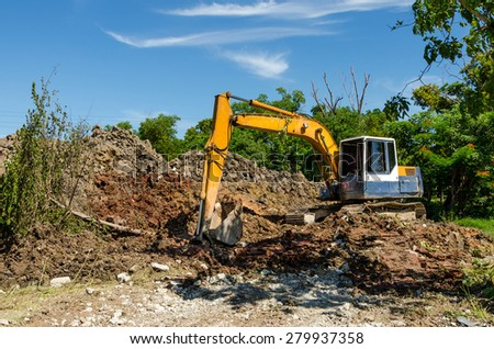Yellow Back Hoe at construction site - stock photo