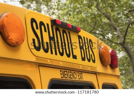 Yellow back of school bus with a sign - stock photo