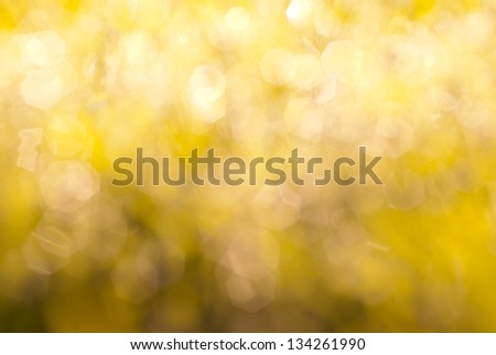 Yellow background with bright glittering lights - stock photo
