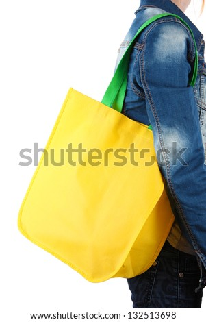 Yellow bag with green handles on shoulder isolated on whit - stock photo