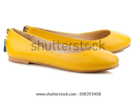 Yellow ballet shoes isolated on white background. - stock photo