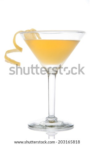 Yellow banana cocktail in martini glass with lemon twist isolated on a white background - stock photo