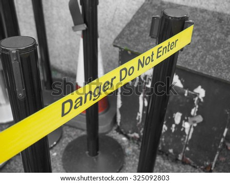 Yellow band fence danger do not enter warning sign