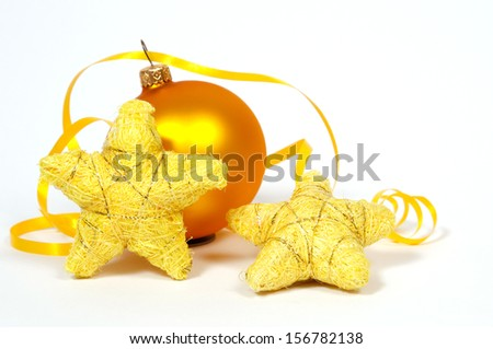 Yellow bauble and yellow stars on the white background - stock photo