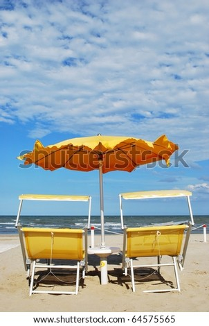 Yellow beach chairs and umbrella, Rimini, Italy