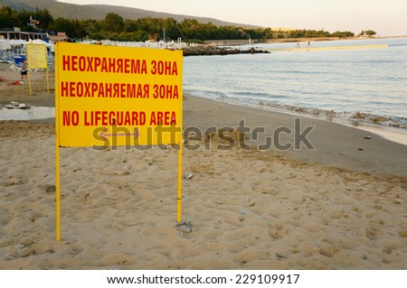 Yellow beach sign warning for no lifeguard area