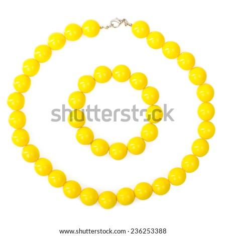 yellow beads and bracelet isolated - stock photo