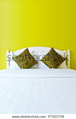 Yellow bedroom in a modern house - home interiors. - stock photo