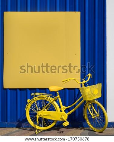 Yellow bicycle - stock photo