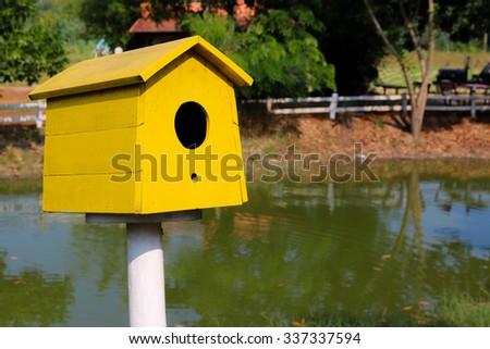 Yellow Bird house  - stock photo