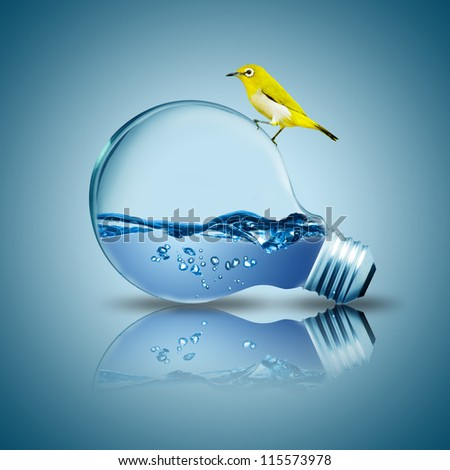 Yellow bird on light bulb with water inside. Concept for environmental friendly - stock photo