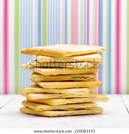 Yellow biscuits on striped background. Close up view.