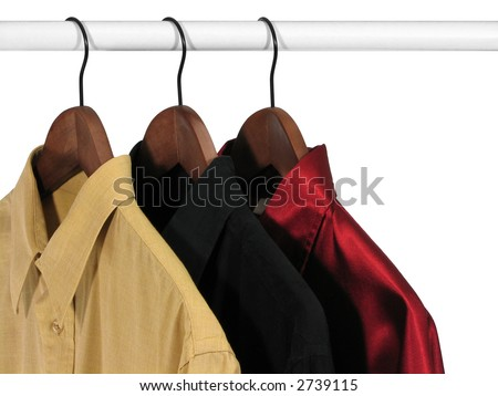 Yellow, black and red shirts on a rack, on white background
