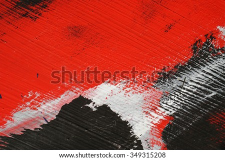 Yellow,black, blue and red   acrylic paint  on a dusty old metal fence - Textured abstract multicolor  background - Close up 2  - stock photo