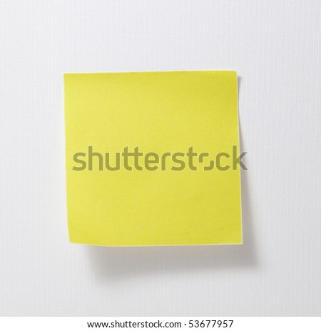 Yellow blank memo on white wall