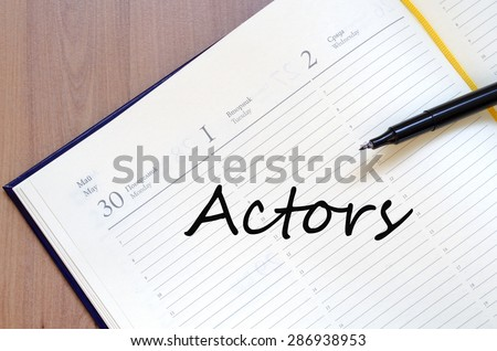 Yellow blank notepad on office wooden table Actors concept