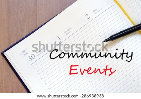 Yellow blank notepad on office wooden table Community events concept