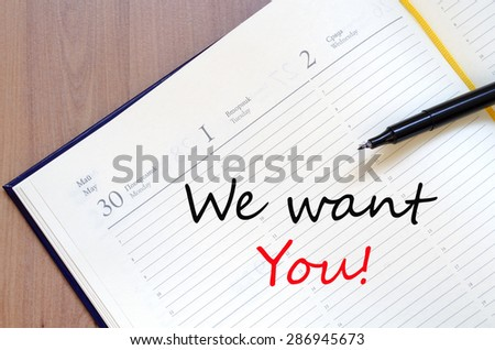 Yellow blank notepad on office wooden table We want you concept