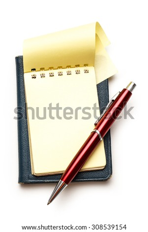 Yellow blank notepad open with red pen